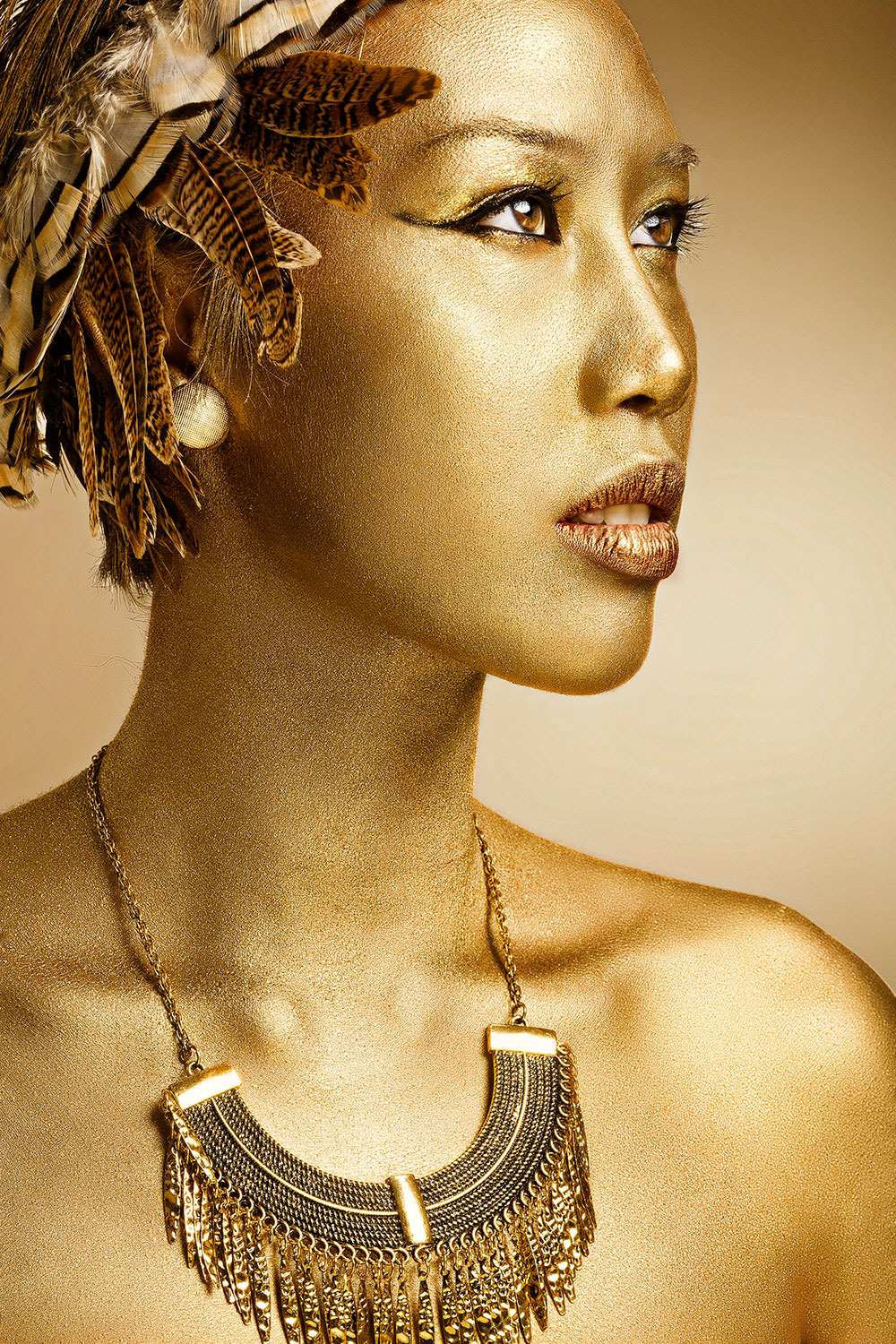 Gold statue by fashion photographer