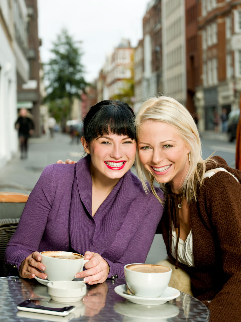 Two Girls Having Warm Coffees