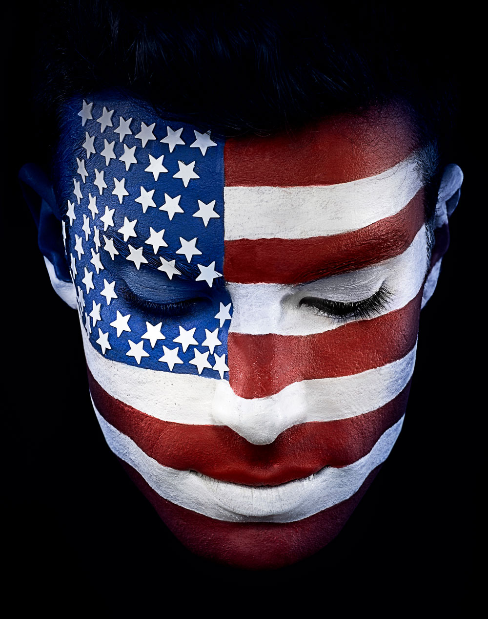 Man's Face Painted as the United States' Flag