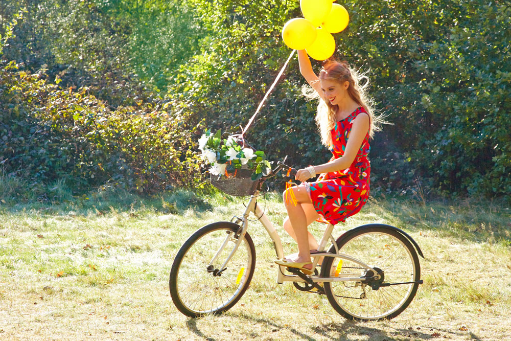 Girl Riding a Vintage Bike with a Yellow Balloon