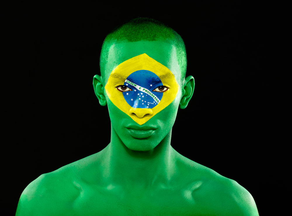 Man Face Painted as the Brazil Flag