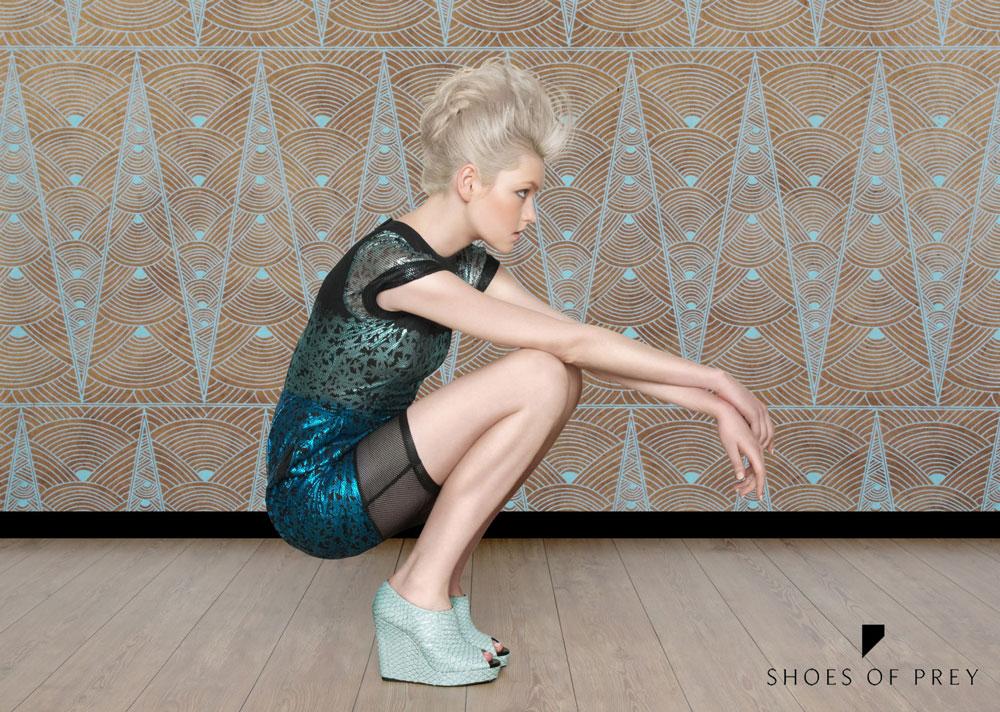 Model wearing shoes of prey heels